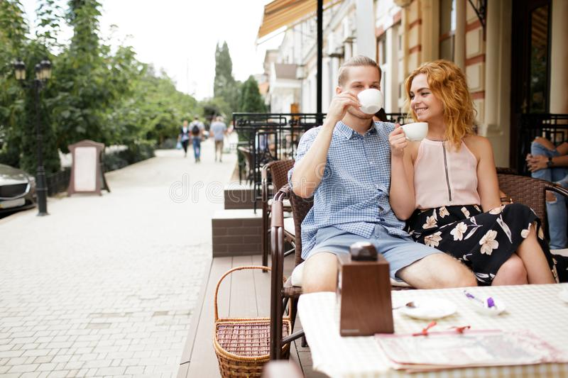 Beautiful couple having coffee on a date,having fun together. stock photography