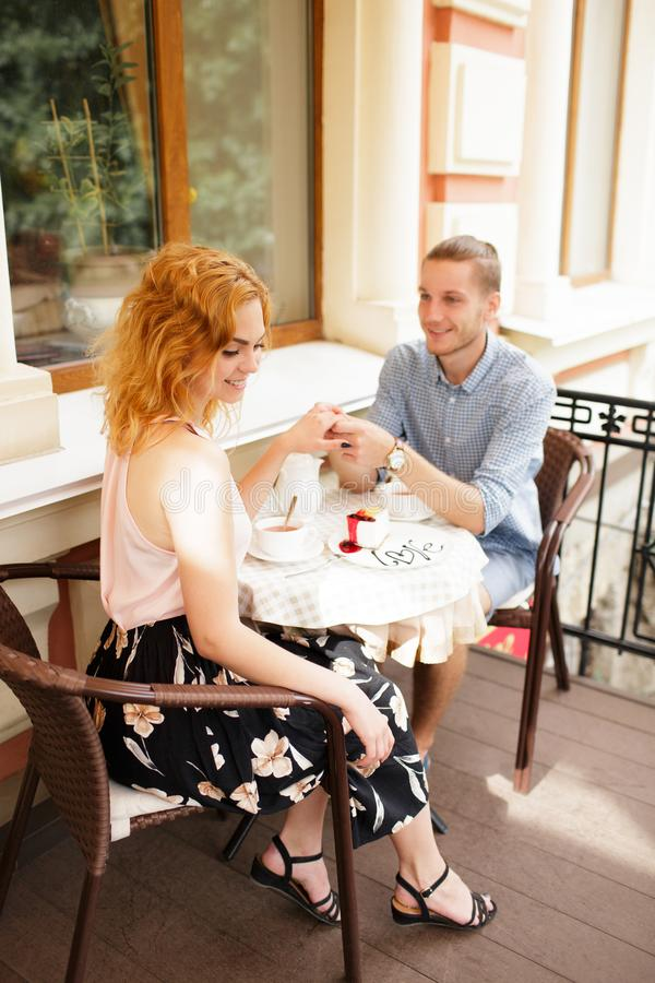 Beautiful couple having coffee on a date,having fun together. royalty free stock photography