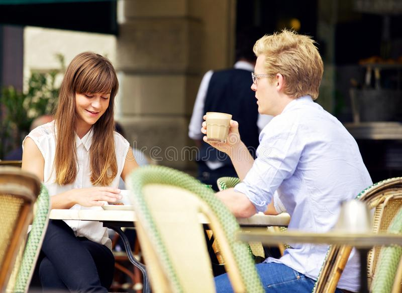 Young Couple Talking Over a Cup of Coffee royalty free stock images