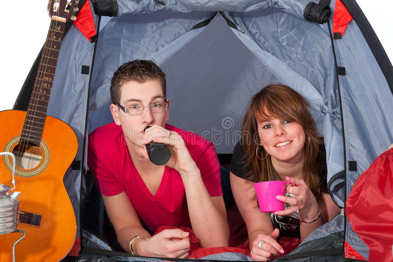 Young couple in a tent. Young couple at the campground in a tent stock photo