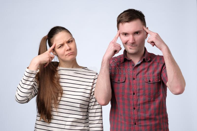 Young couple thinking puzzled about their family budget royalty free stock images