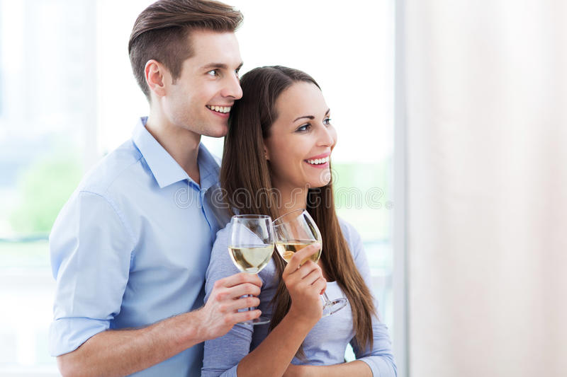 Download Young couple toasting stock photo. Image of happy, embracing - 31587456