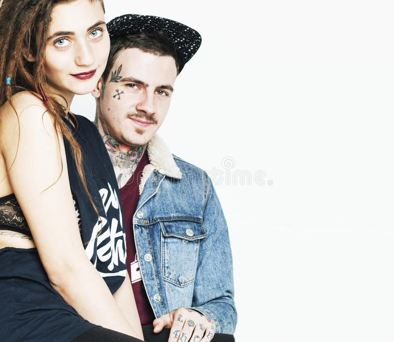 Young couple together making love, hugging. guy with tattoo, gir. Lfriend wearing dreadlocks. Modern lifestyle concept, unsocial family royalty free stock photos
