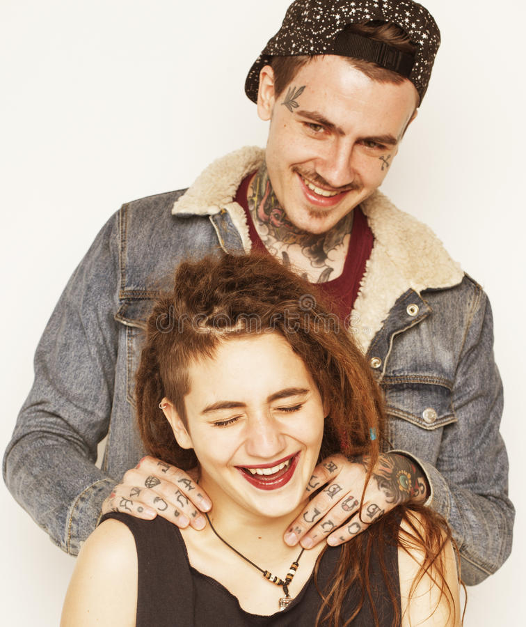 Young couple together making love, hugging. guy with tattoo, girlfriend wearing dreadlocks. Modern lifestyle concept. Unsocial family royalty free stock photos
