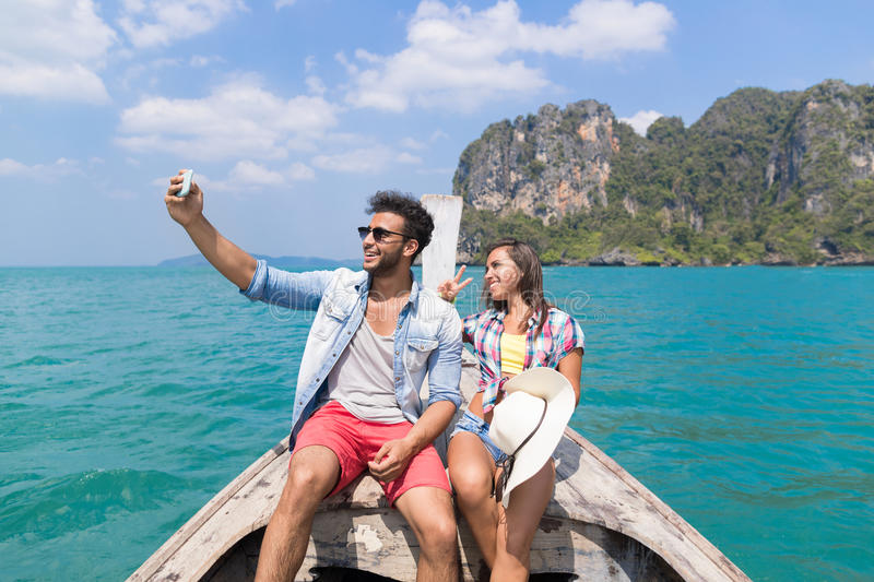 Young Couple Tourist Sail Long Tail Thailand Boat Take Selfie Photo Ocean Sea Vacation Travel Trip royalty free stock images