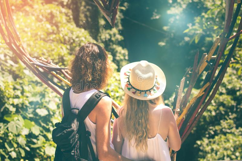 Young couple tourists in the jungle of Bali island, Indonesia. Young couple tourists in the jungle of Bali island royalty free stock photo