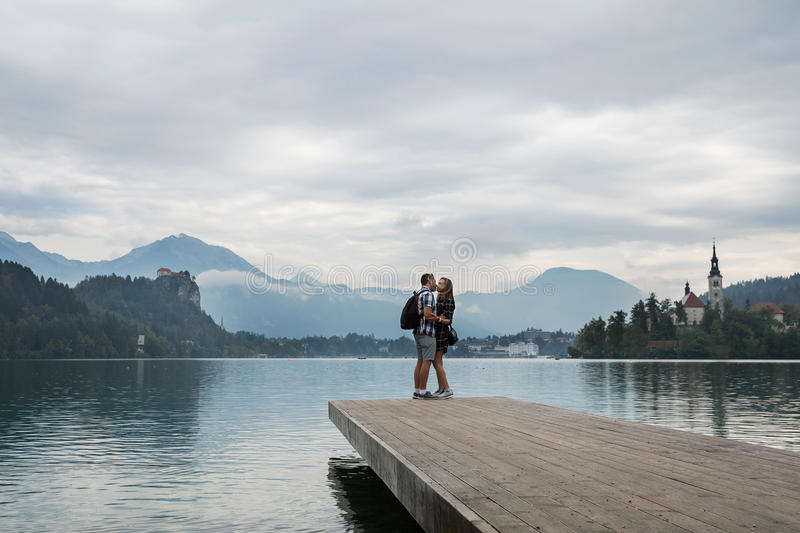 Young couple of tourists in love on the Lake Bled, Slovenia. stock images