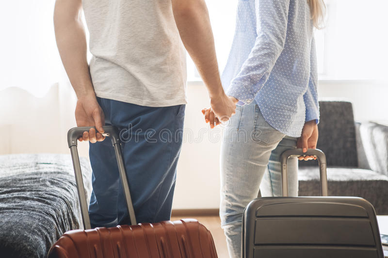 Young couple travel together hotel room leisure. Young men and women together tourism hotel carry luggage stock photography