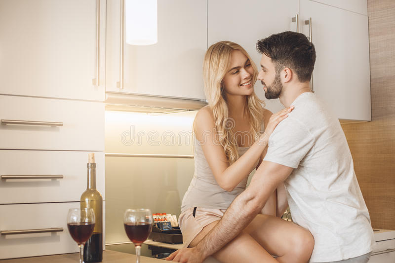 Young couple travel together hotel room leisure. Young men and women together tourism hotel kitchen stock photos