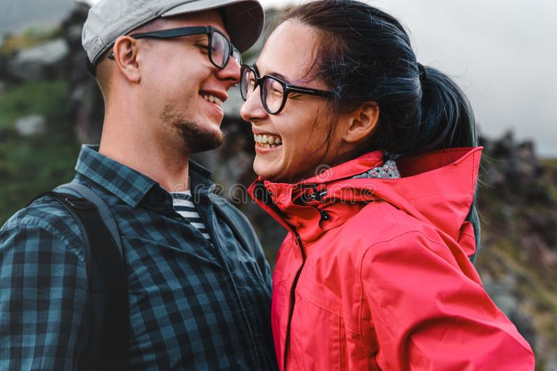 Young Couple Travelers Laugh And Enjoy The Journey. Young couple, men and women travelers hug, laugh and enjoy a hike royalty free stock photo