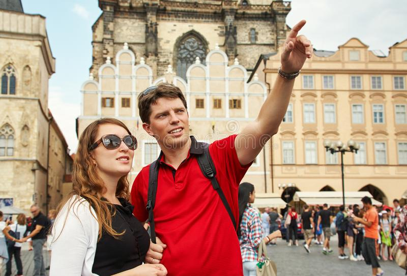 Young couple travelers walking on a street of European city. sightseeing traveler. Prague, Old Town Square. stock image