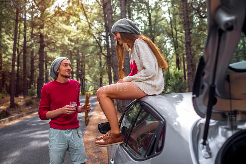 Young couple traveling by car in the forest stock images