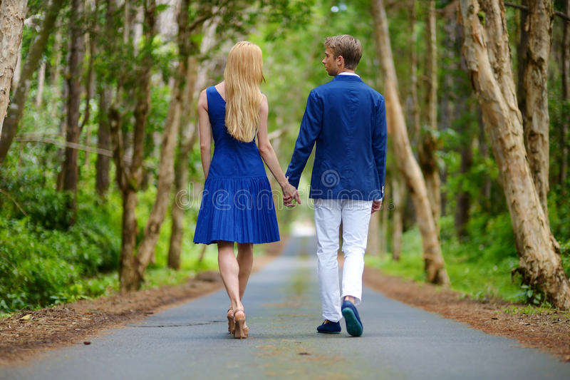 Young couple on a tropical island. Young beautiful couple having fun in a park royalty free stock photo