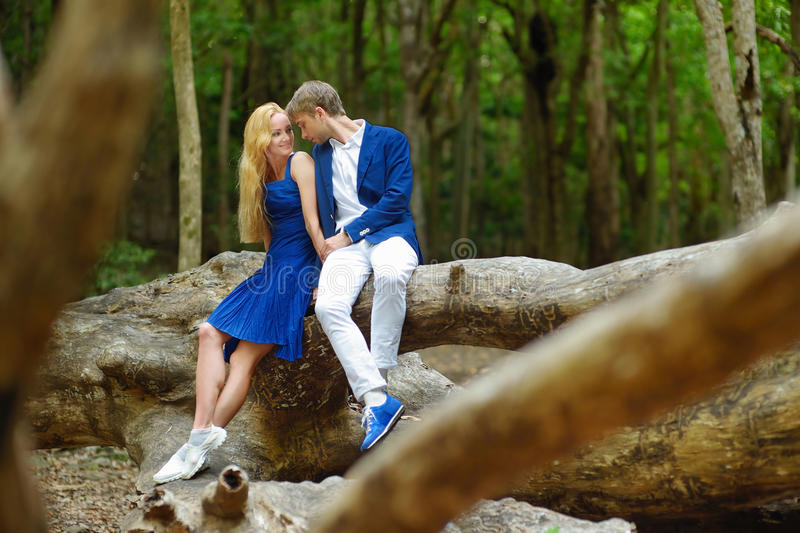 Young couple on a tropical island. Young beautiful couple having fun in a park stock photo
