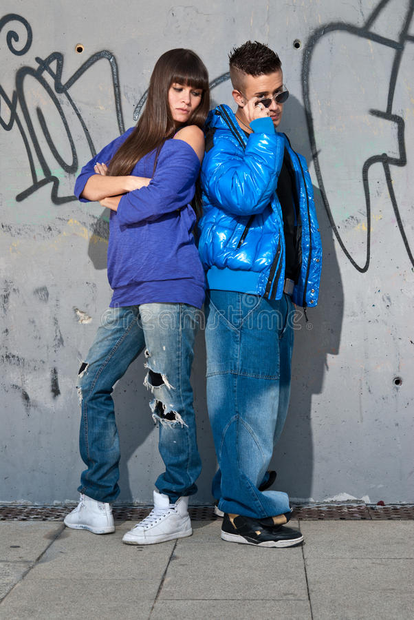 Download Young Couple Urban Fashion Standing Portrait Wall Stock Image - Image: 16925667