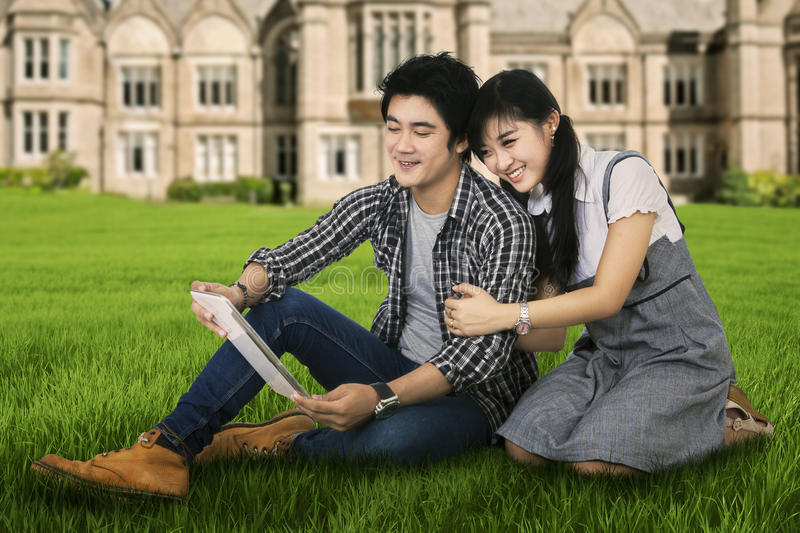 Young couple using a digital tablet outdoor royalty free stock image