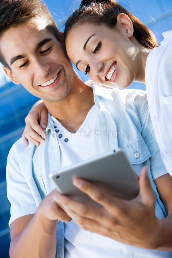 Download Young Couple Using A Digital Tablet Stock Photo - Image: 32948974