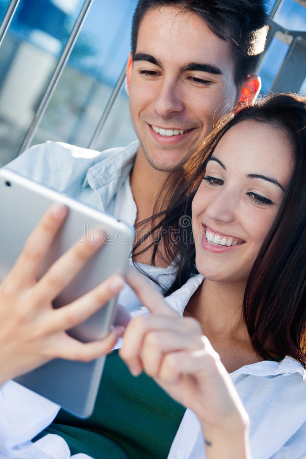 Download Young Couple Using A Digital Tablet Stock Photo - Image: 32951294