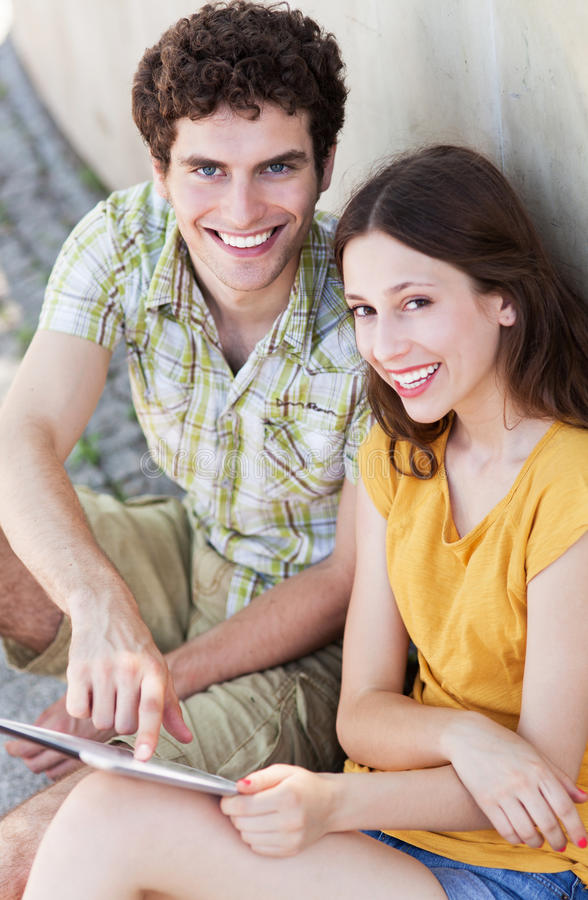 Download Young Couple Using Digital Tablet Stock Image - Image: 32386945