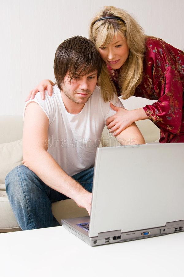 Download Young couple using laptop stock photo. Image of relaxed - 3566364