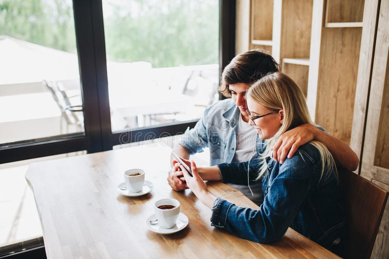 Young couple using tablet while sitting together at cafe stock photos