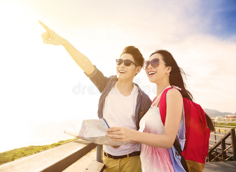 young couple on vacation and looking at view stock photos