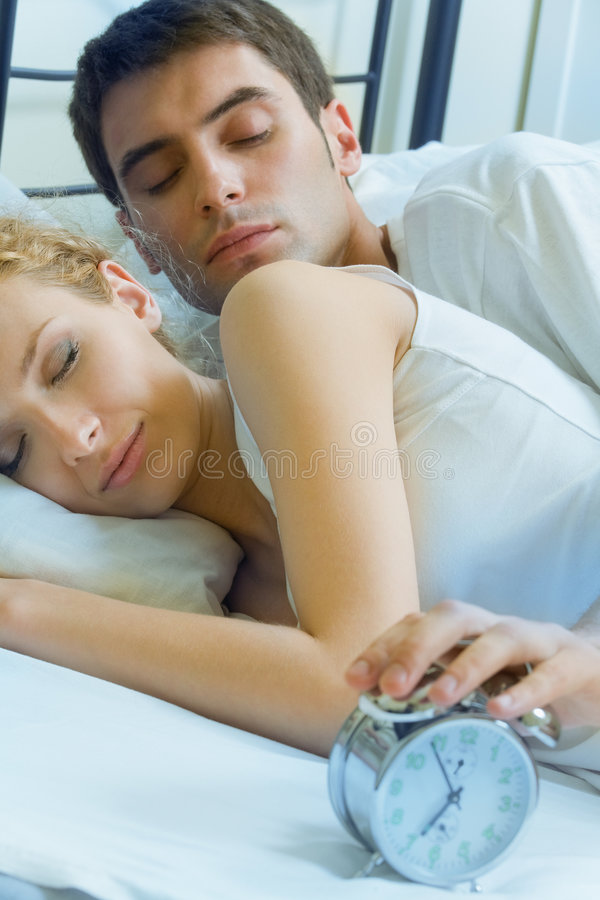 Young couple waking up