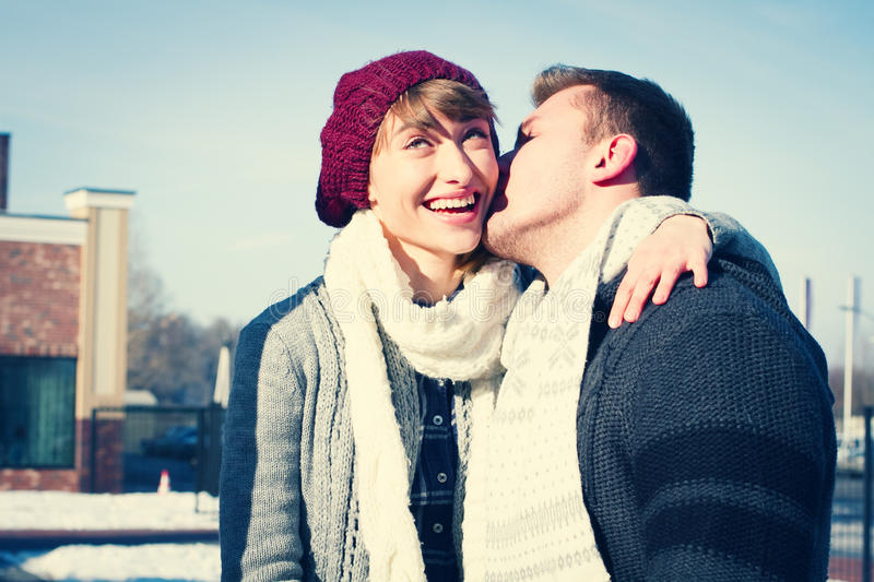 Young couple walking around city in winter. royalty free stock photos
