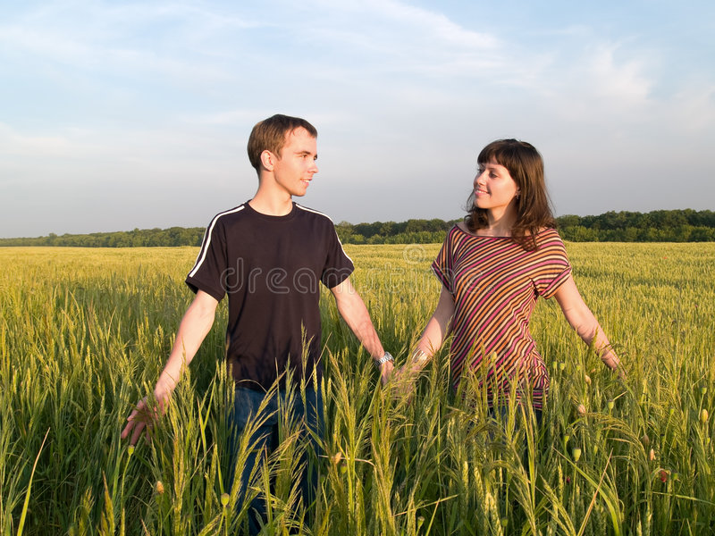Download Young Couple Walking Field Holding Hands Stock Image - Image: 5505211