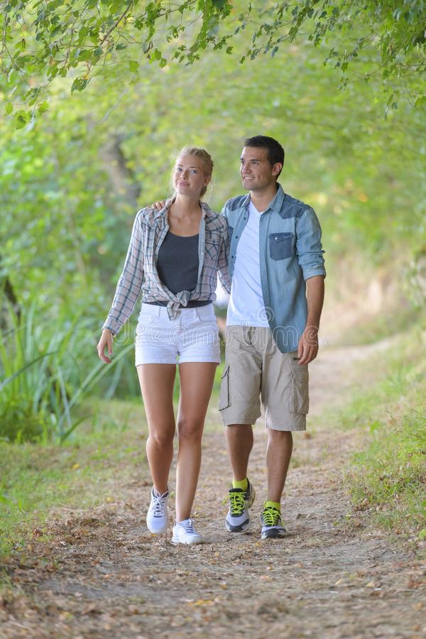 Young couple walking in forest stock photos