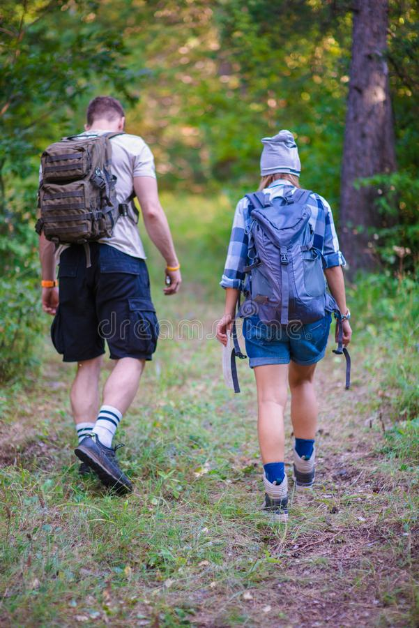 Young couple walking in the forest royalty free stock photo