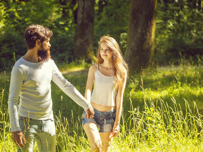Young couple walking in forest stock photography