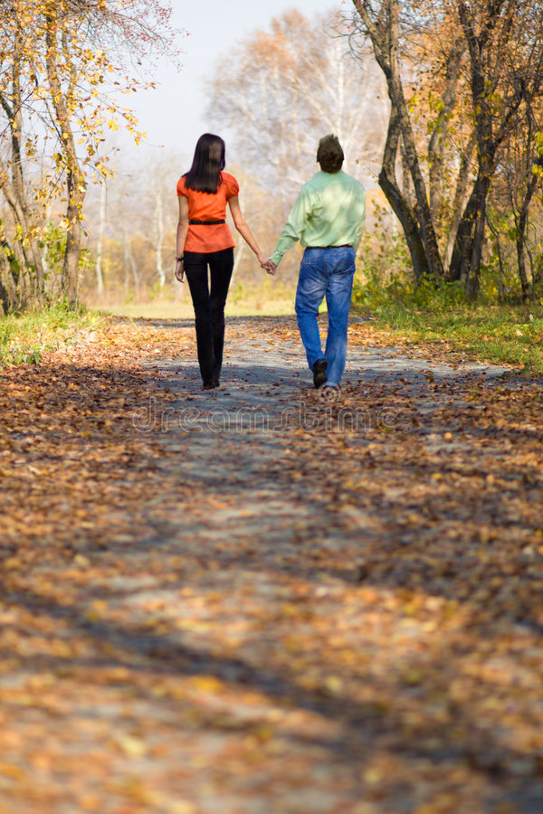 Free Young Couple Walking In The Park Stock Photo - 6770300