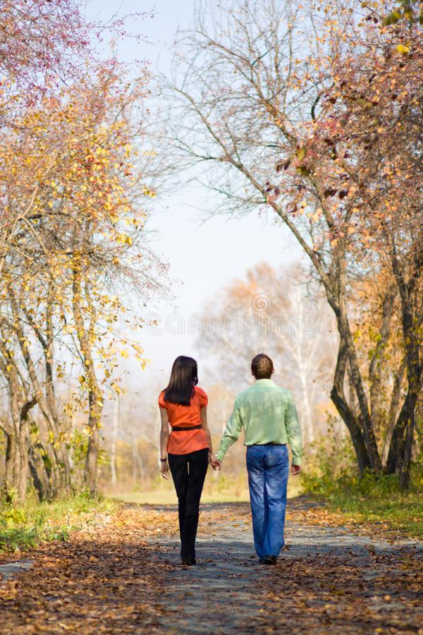 Young couple walking in the park royalty free stock photo