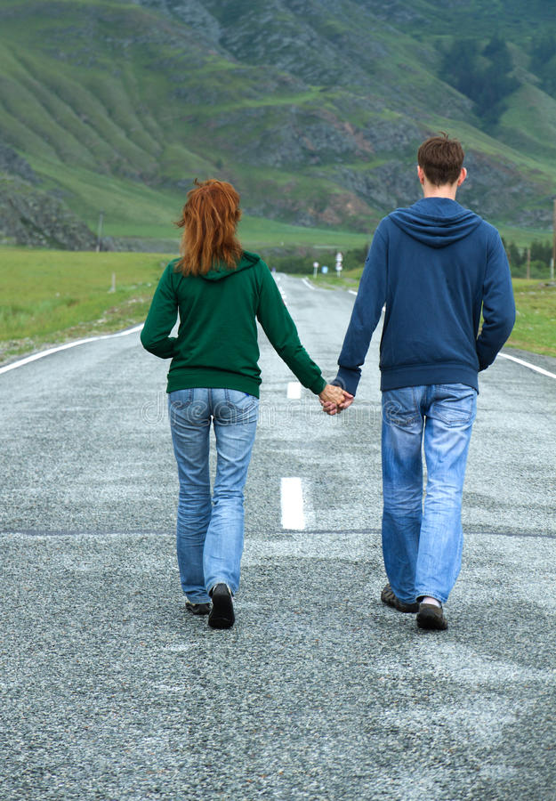 Young couple walking road royalty free stock images