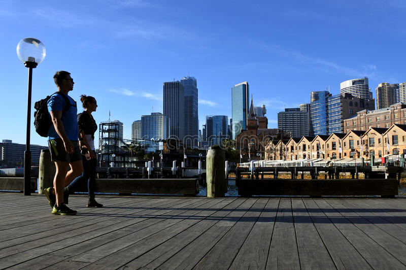 Young couple walks along Sydney Circular Quay Sydney New South stock photo