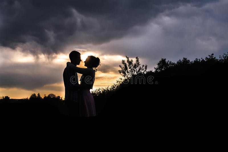 A young couple walks royalty free stock images