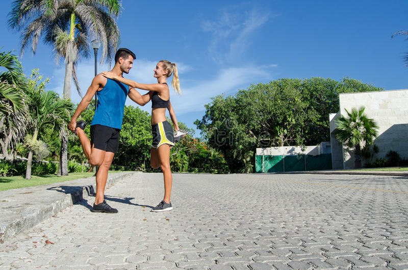Couple warming up before running stock image