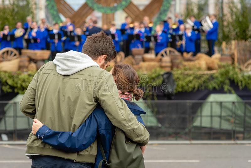 A young couple are watching a concert. View from the back. A young couple are watching a concert. View from the back royalty free stock photo