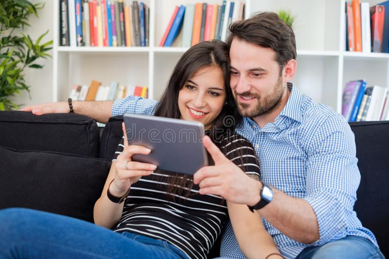 Young couple watching internet media content on digital tablet stock photos