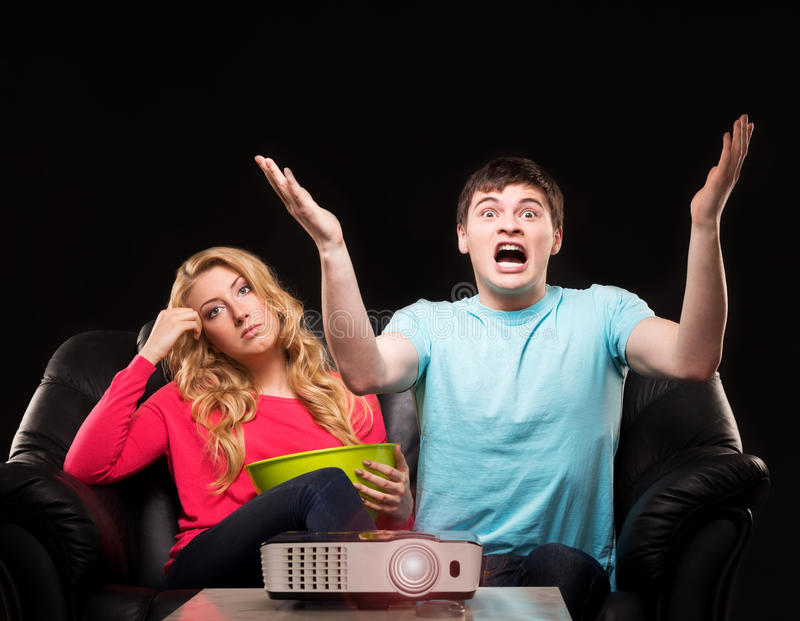 Young couple watching a movie stock image