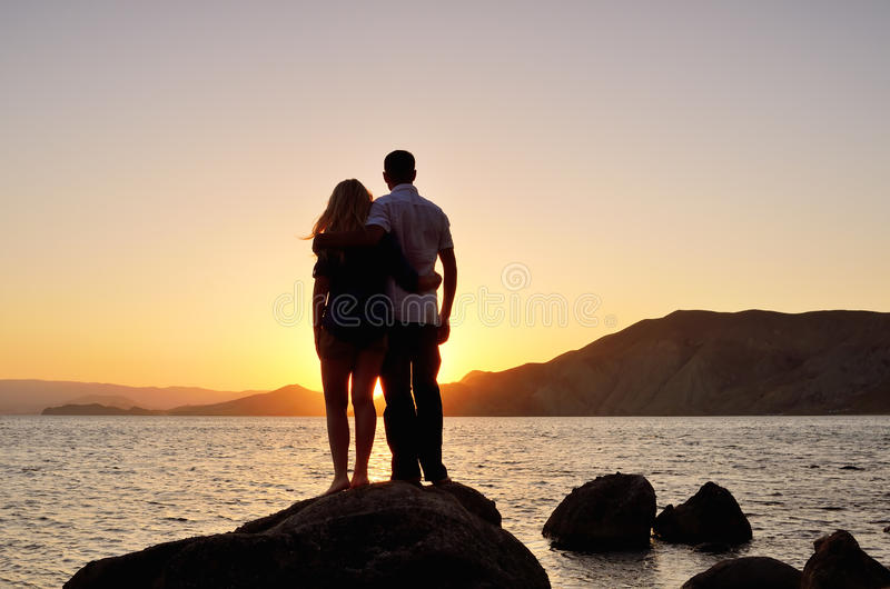 Young couple watching the sun