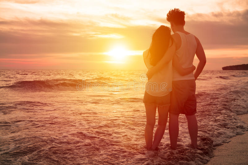 Young couple watching sunset royalty free stock photo