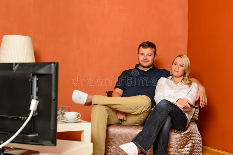 Download Young Couple Watching Tv Cuddling Sitting Armchair Stock Photo - Image: 29247816
