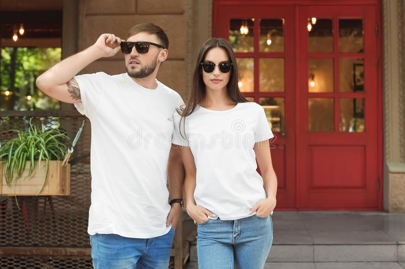 Young couple wearing white t-shirts stock photos