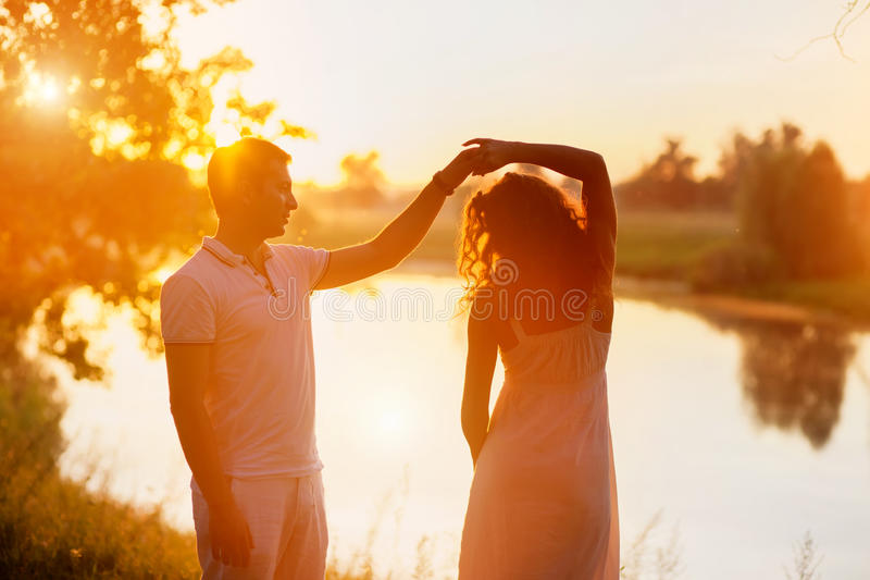 Young Couple In White Dancing On The Background Of Sunset Royalty Free Stock Photos