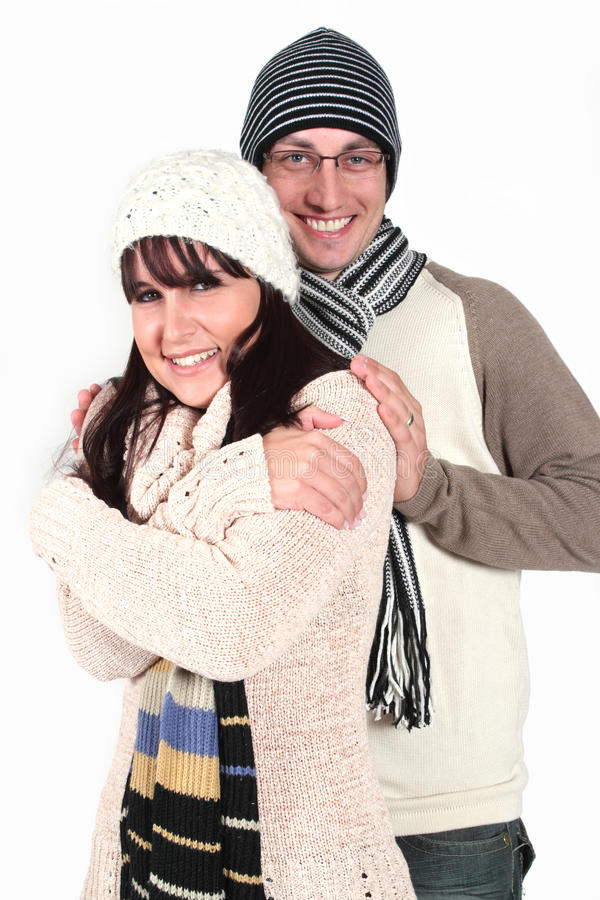 Young couple in winter clothes royalty free stock photos