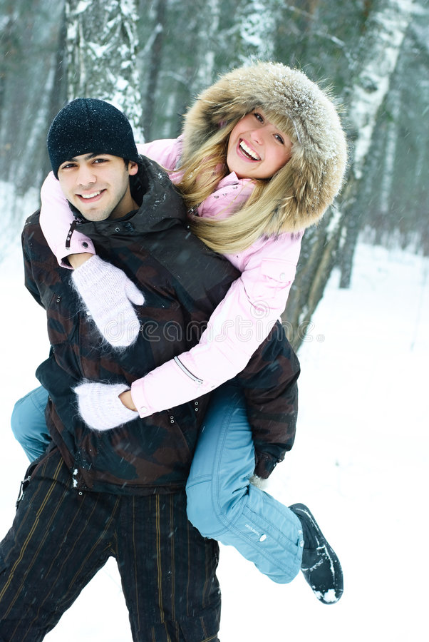 Young couple in winter park royalty free stock images
