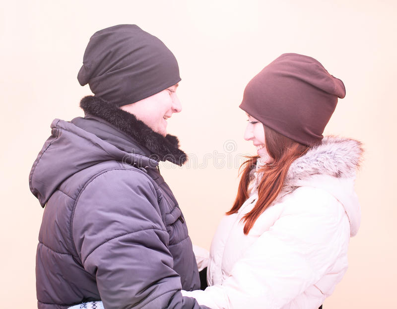 Young couple in winter park, woods, resting enjoying walk, happy family, idea style concept love relationships royalty free stock photography