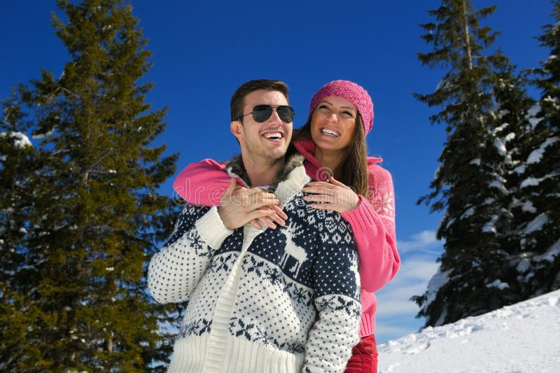 Young Couple In Winter Snow Scene. At beautiful sunny day stock photos